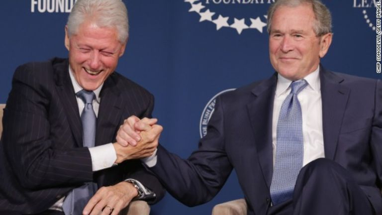 George Bush shakes hand with Bill Clinton