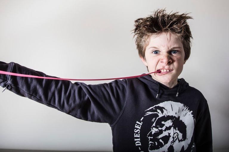 Boy chews sticky chewing gum
