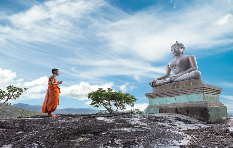 Buddha statue and young monk
