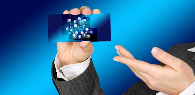 Hands presenting an internet business card