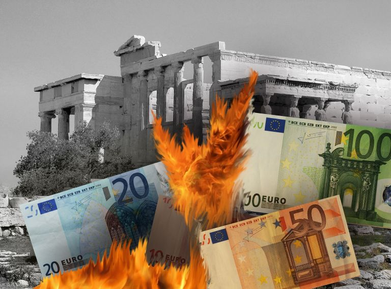Burning euro notes with ruins