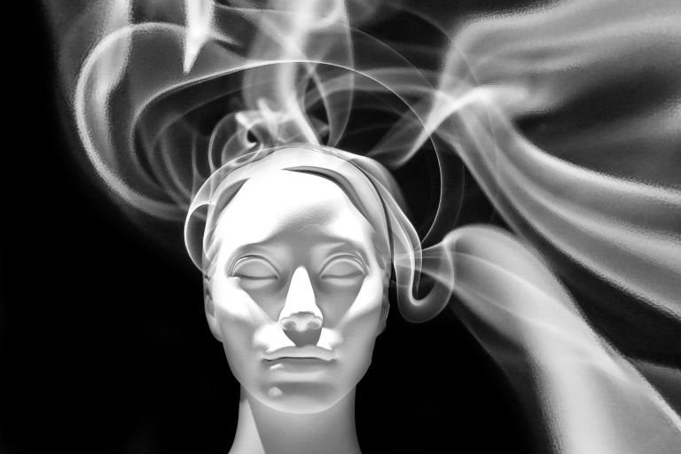 Face in meditation with smoke
