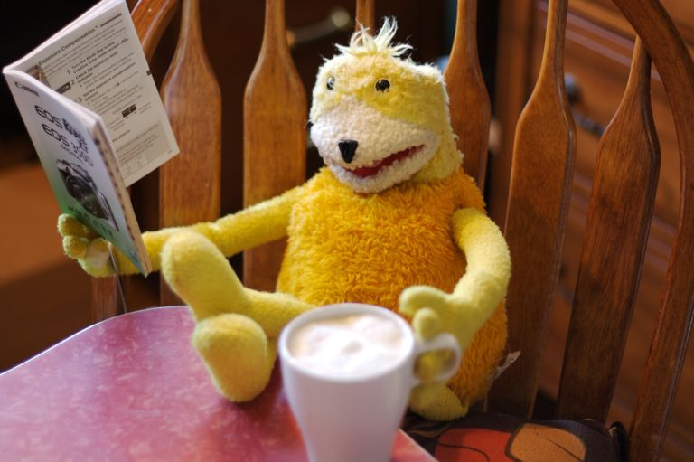 Cool yellow puppet: Flat Eric (Mr. Oizo)( drinking coffee and reading newspaper