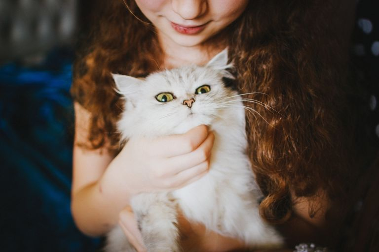Girl with white pussy-cat