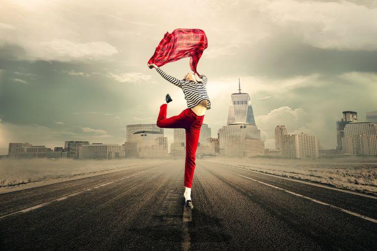 Girl: Exuberantly dancing on a street, joy, happiness, energy