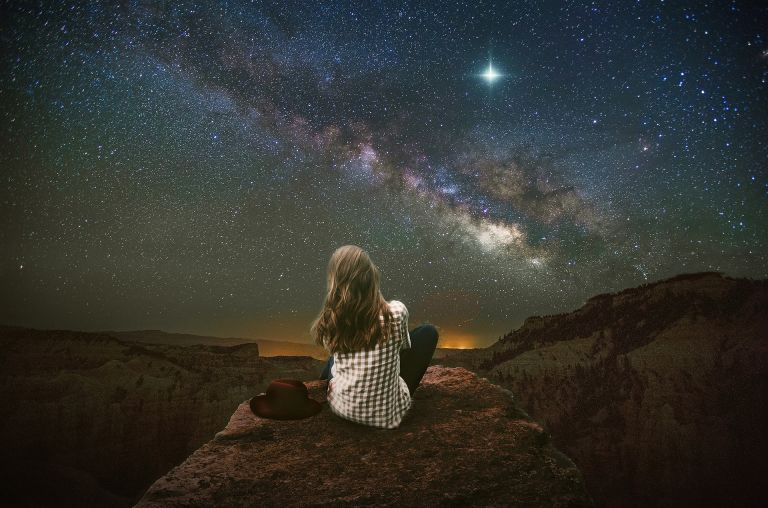 Girl looking into stars and the universe, landscape