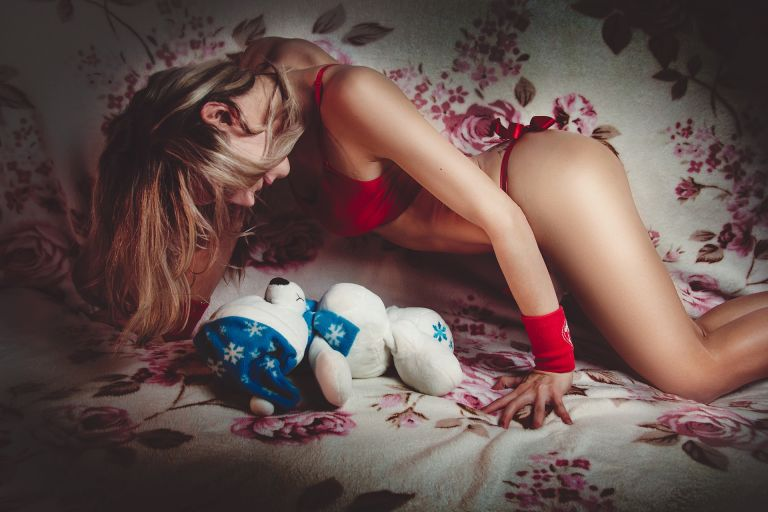 Sexy girl with red lingerie and white polar teddy bear