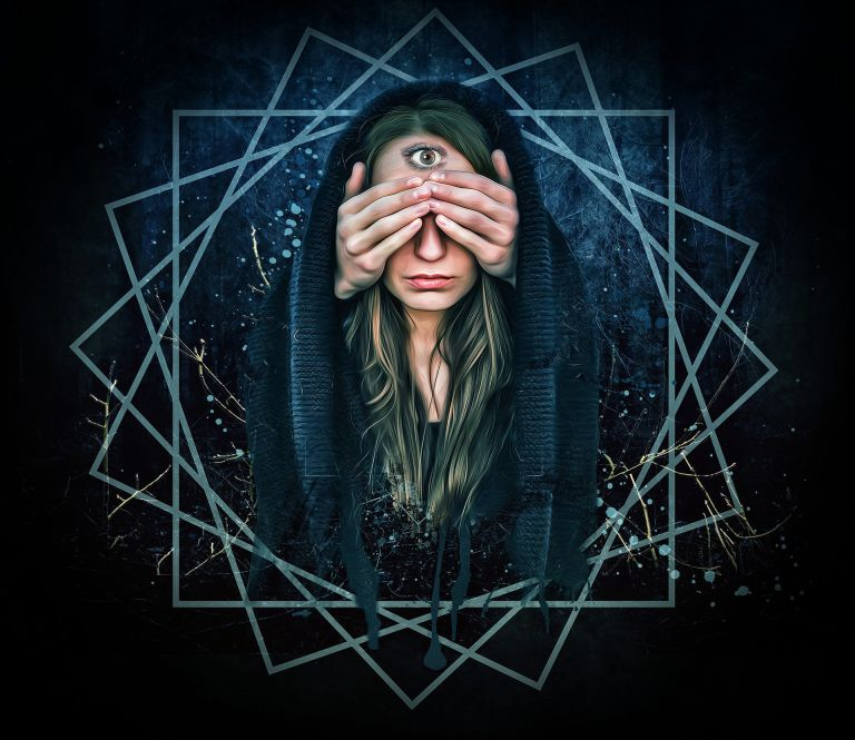 Mystic woman, third eye, intuition, hands in front of eyes