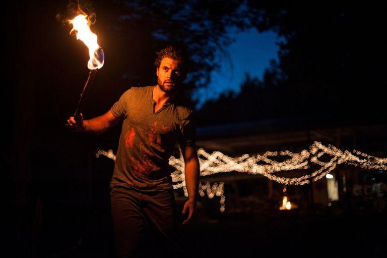 Man, guy, holding torch in dark, black night