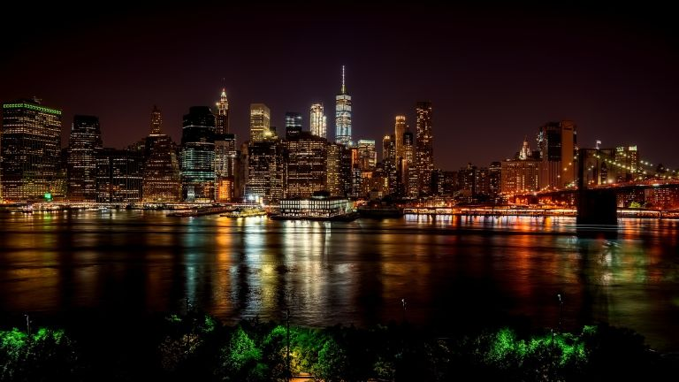 New York City: Skyline with reflection in Hudson river