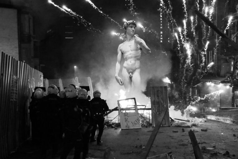 Revolution and rebellion on the streets. Fighting, police, statue of David