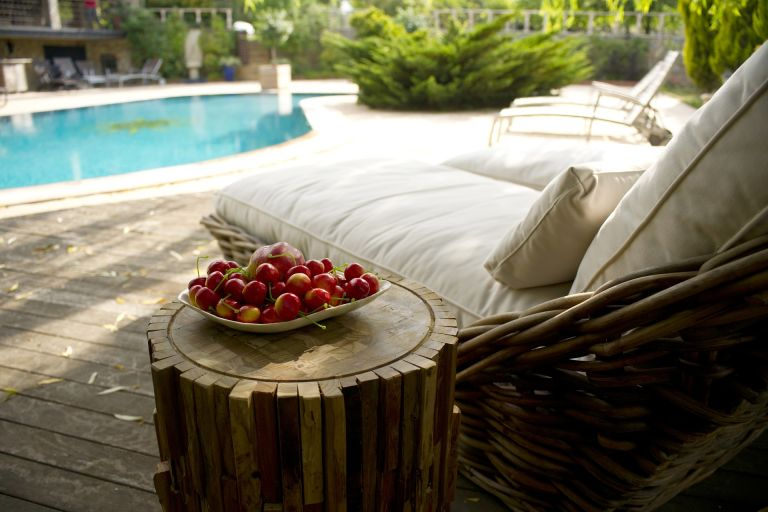 Sunbeds at pool with fruits