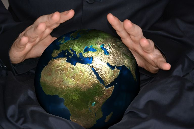 Seance with psychic: Hands over global ball planet earth
