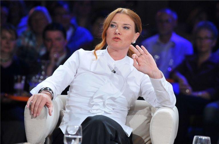 Tatjana Strobel, sitting in a tv show