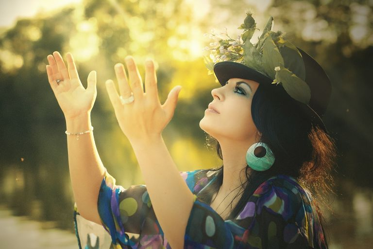 Beauty, woman, holding hands up, flowered hat