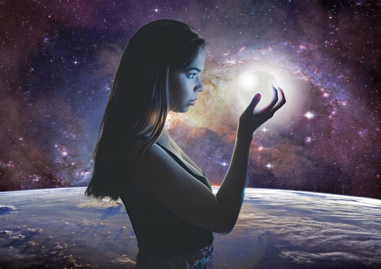 Woman with galaxies in hand: Universe and planets
