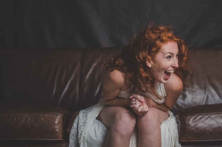 Laughing woman with red hair