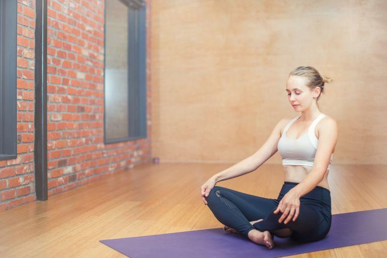 Woman on yoga mat. Meditating.