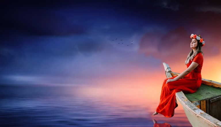 Woman relaxing on a boat on a fantasy sea