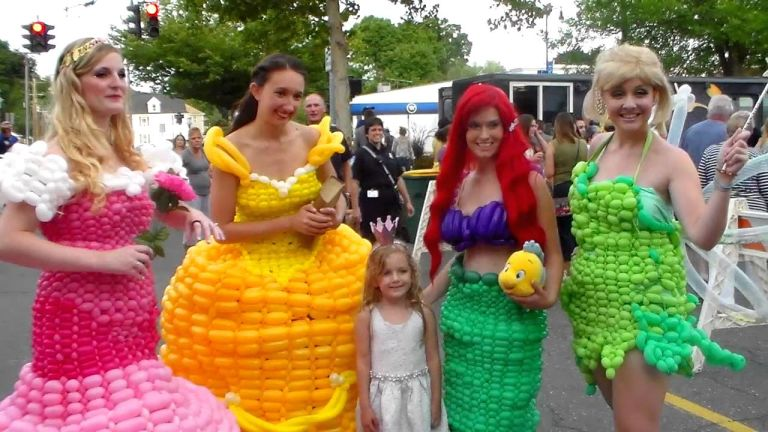 Women with fashion-dresses made out of balloons