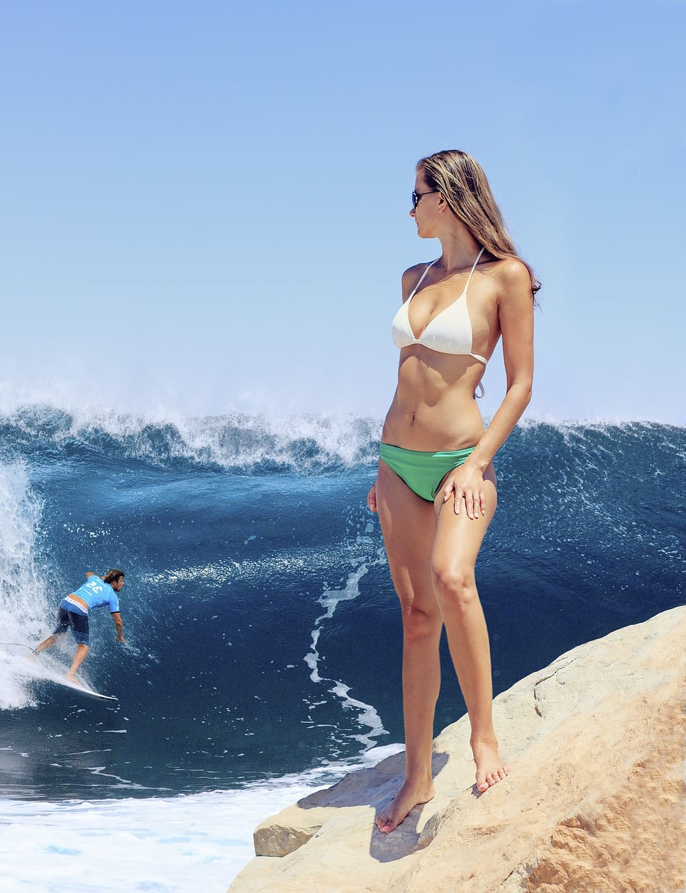 Surfer in huge wave with bikini girl