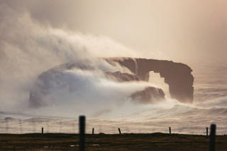 Natural arch, Dore Holm, in stormy seas