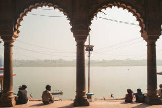 People sat in arches overlooking the sangam