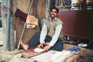 Man making bread in the street