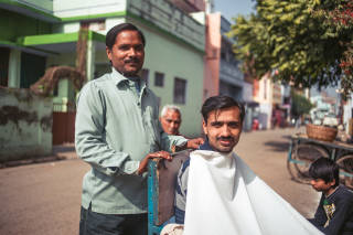 Man having a haircut in the street