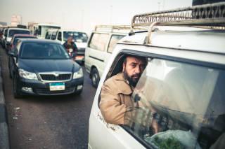 Man on minibus, Cairo