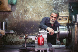 Man working with laithe, Cairo