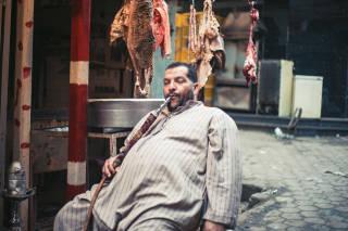 Man smoking pipe on the street, Cairo
