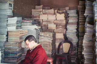 Man surrounded by literature, Cairo