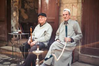 Two men smoking on the street, Cairo