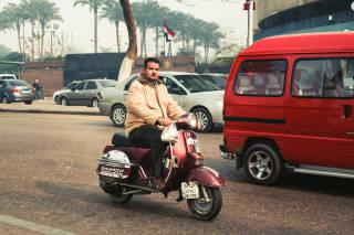 Moped rider, Cairo