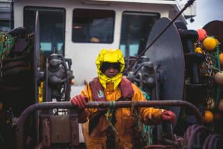 Fisherman operating a winch