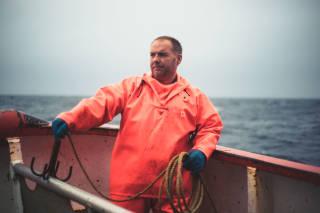 Fisherman holding hook