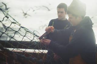 Fishermen mending the net