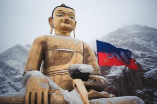 Buddha statue in a snowy landscape
