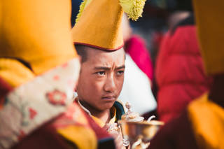Young monk at festival