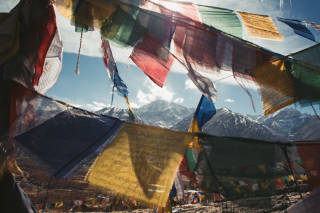 Mountain scene through prayer flags