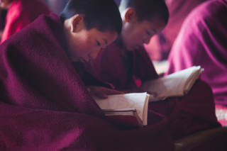 Boys reading religious text