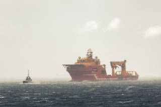 Offshore vessel behind pilot vessel