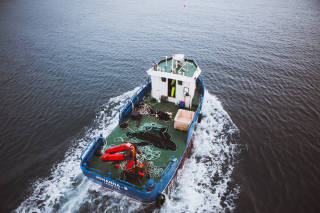 Salmon farm boat at sea