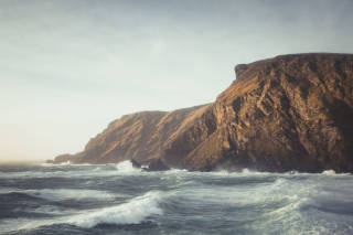 Stormy seas and high cliffs
