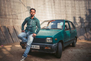 Driver poses with car