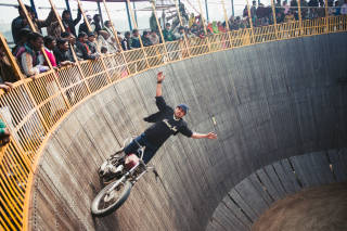 Motorcyclist riding the well of death