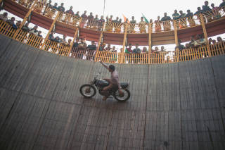 Motorcyclist in well of death