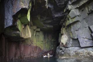 Kayaker in cave near Boddam