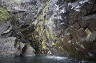 Kayaker below small waterfall, Boddam